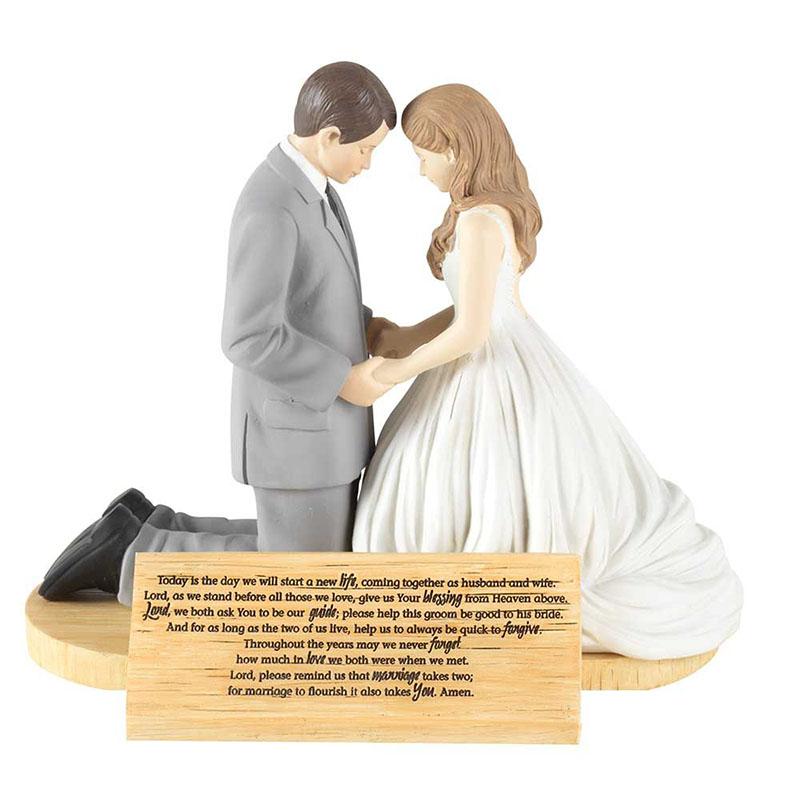 Figura para pastel Pareja Rezando por su Unión.