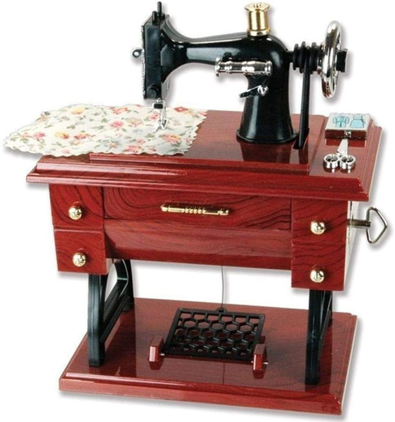 Caja musical en forma de maquina de costura